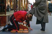Shoeshine boy polishing man's shoes