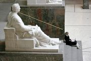 sitting by statue
