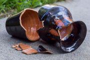 Smashed vase lying broken on path
