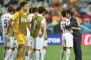South Koreas football coach hugs one player
