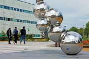 Students walking past sculpture, Loughborough University