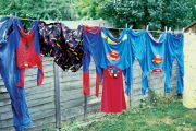 Superhero costumes hanging on a washing line