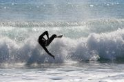 Surfer wiping out on wave, Mojácar, spain