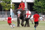 Thai students play soccer with elephants, 2014