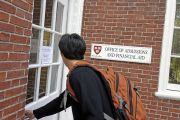 Freshman entering Harvard admissions building