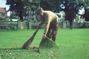 man sweeping under