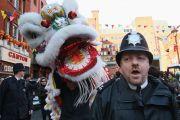 British policeman with Chinese dragon