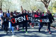 A group of students shout slogans and hold banners at Stellenbosch University in Cape Town, South Africa
