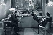 men in office with feet on desk. Vintage