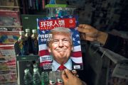 "A Chinese magazine with a cover story that translates to ""Why did Trump win"" is seen with a front cover portrait of Donald Trump"