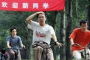 Tsinghua University students riding bicycles on campus