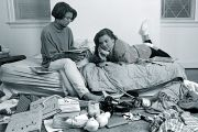 Two teenage girls in a messy bedroom
