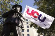 University and College Union (UCU) flag hanging on statue
