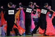University-branded ballroom dancers dancing