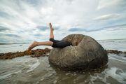 Woman falling into rock on beach