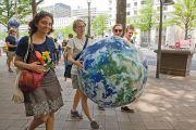 Women carrying the world
