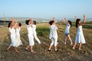 Women dancing in field celebrating Spring Harvest