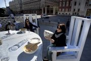 Women sitting at giant table