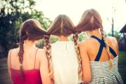 Women with hair tied together