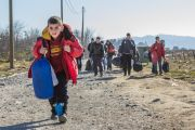 Young boy leads caravan of Syrian refugees