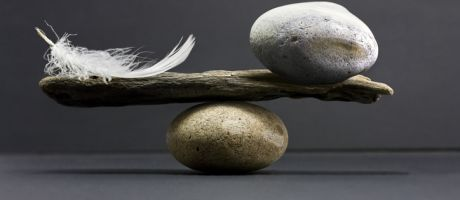 A feather and a stone equally balanced