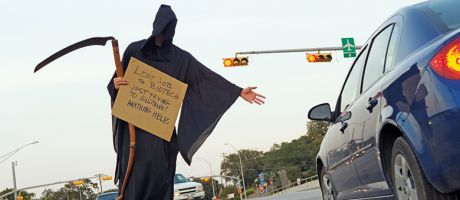 Person dressed as Grim Reaper