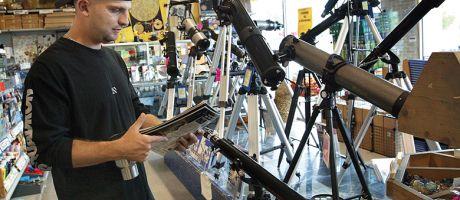 man in telescope shop
