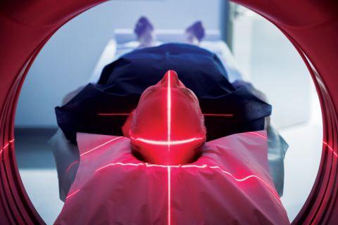 Elderly man lying down in Body CT (CAT Scan) machine