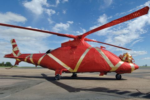 Gift-wrapped helicopter on launch pad