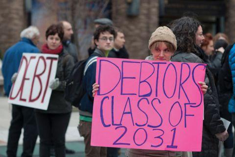 Student demonstrators holding 'Debtors class of 2031' sign