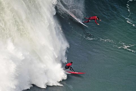 surfers compete