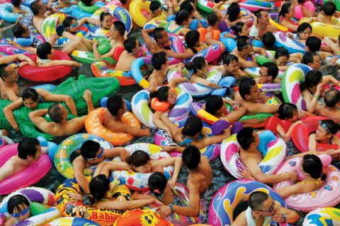Swimmers in artificial wave pool, Suining, Sichuan province, China