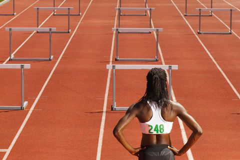 woman in front of hurdles