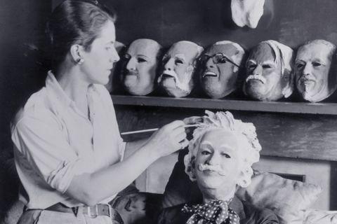 Woman making plaster puppet