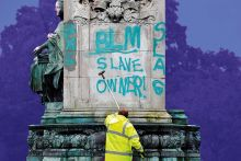 Council workers clean a statue of Queen Victoria in Woodhouse Moor Park in Leeds, 2020