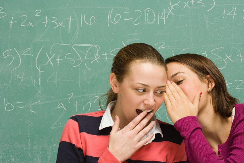students telling a secret