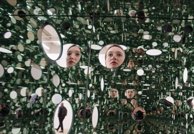 Face repeated in series of mirrors