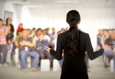 A female speaker addressing a conference