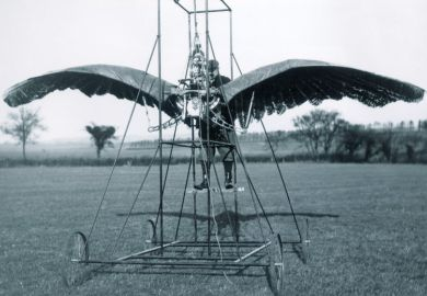 A man inside a winged contraption