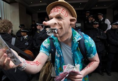 A protester wearing a greed mask holding fake money