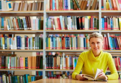 A woman sitting in a library