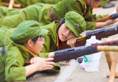 A Chinese female university student during compulsory university military training