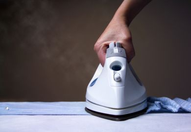 A steam iron ironing a shirt, representing smoothing out inequality