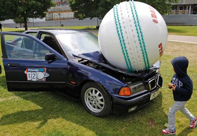 A ball crushing a car
