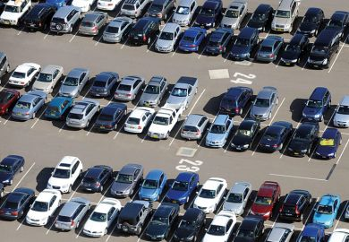 Aerial view of cars parked in airport long term parking
