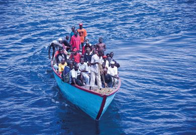 African people in overpacked boat