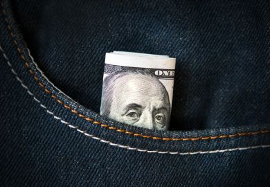 American banknote in jeans