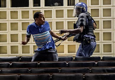 Anti-riot policeman reacts towards student protestor, University of the Witwatersrand