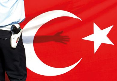 Armed guard standing in front of flag of Turkey