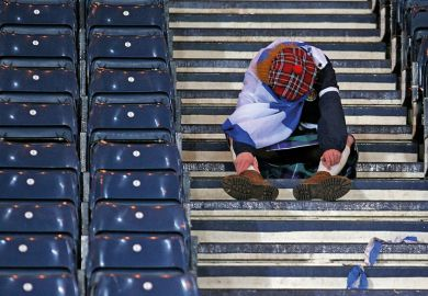 A Scot sitting down on some steps